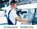 Worker Entering Data In Cnc...