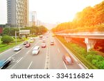 fast cars drived through city... | Shutterstock . vector #334116824