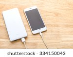 smartphone charging with power... | Shutterstock . vector #334150043