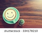 coffee cup   cactus on wooden... | Shutterstock . vector #334178210