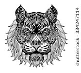ethnic patterned head of lion   ... | Shutterstock .eps vector #334247114