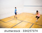 couple playing a game of squash ... | Shutterstock . vector #334257374