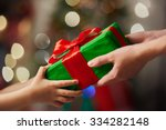 hands of parent giving a... | Shutterstock . vector #334282148