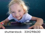 Child On A Climbing Wall In A...
