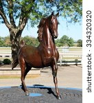 Small photo of LEXINGTON, KY-OCTOBER, 2015: Bronze statue of Secretariat, one of the finest thoroughbred horses of all time.