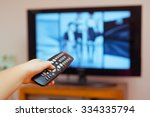 kid holding tv remote controller | Shutterstock . vector #334335794
