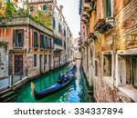 Traditional Gondolas On Narrow...