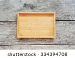 wooden tray on wood background. | Shutterstock . vector #334394708