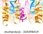 colorful serpentine streamers... | Shutterstock . vector #334398419