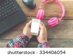 hand hold smart phone laptop... | Shutterstock . vector #334406054