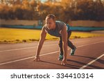 athletic man standing in a... | Shutterstock . vector #334410314