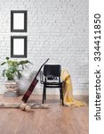 frame brick wall black chair... | Shutterstock . vector #334411850