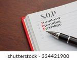 close up sop on notebook with... | Shutterstock . vector #334421900