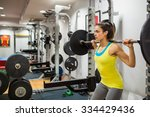 Determined Woman Lifting A...