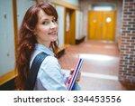 mature student opening her... | Shutterstock . vector #334453556
