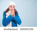 frozen girl in blue coat  white ... | Shutterstock . vector #334492190