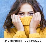 Stock photo beautiful natural young shy brunette woman with smiling eyes wearing knitted sweater 334503236