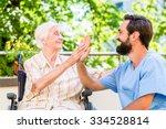 senior woman and nurse giving... | Shutterstock . vector #334528814