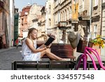 girl with pink bicycle and... | Shutterstock . vector #334557548