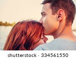 handsome young man kissing his... | Shutterstock . vector #334561550