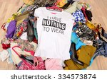 big pile of clothes thrown on... | Shutterstock . vector #334573874
