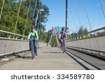 a happy couple ride their... | Shutterstock . vector #334589780