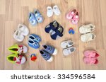 baby shoes arranged on the... | Shutterstock . vector #334596584