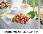 catering buffet table with a...   Shutterstock . vector #334634444