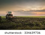 tractor plowing a field at dusk | Shutterstock . vector #334639736