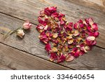 Dried Rose Petals On Wooden...