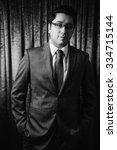 male model posing in suit ... | Shutterstock . vector #334715144
