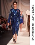 Small photo of A model walks on the ALENA AKHMADULLINA catwalk. Spring/Summer 2016. MERCEDES-BENZ FASHION WEEK RUSSIA. 22 October 2015, Moscow, Russia.