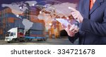 hand presses on world map with... | Shutterstock . vector #334721678