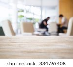 table top with blurred people... | Shutterstock . vector #334769408