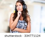 worried woman listening to music | Shutterstock . vector #334771124