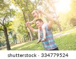 father and daughter playing at... | Shutterstock . vector #334779524