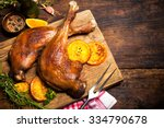 roasted goose legs with oranges ... | Shutterstock . vector #334790678