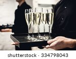 a waiter holding glasses with... | Shutterstock . vector #334798043