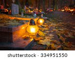 Small photo of Colorful candles on the cemetery at All Saints Day, Poland
