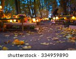 Colorful candles on the cemetery at All Saints Day, Poland - stock photo