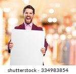 angry businessman with banner | Shutterstock . vector #334983854