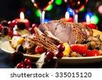 juicy roast pork on the holiday ... | Shutterstock . vector #335015120
