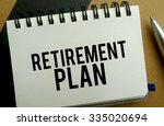 Retirement plan memo written on a notebook with pen - stock photo