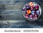 Old Metal Plate With Plums Over ...