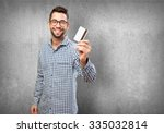 man holding a credit card   Shutterstock . vector #335032814
