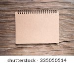 top view notebook paper on wood ... | Shutterstock . vector #335050514