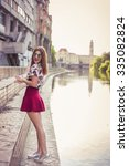 stylish woman posing street... | Shutterstock . vector #335082824
