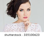 beautiful bride in white dress.  | Shutterstock . vector #335100623