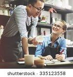 man woman craftsman talking... | Shutterstock . vector #335123558