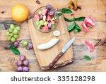 top shot of salad with fresh... | Shutterstock . vector #335128298